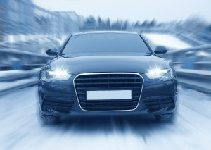 front view of modern car driving fast
