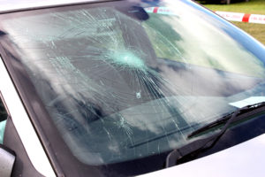 a car in need of windshield crack repair