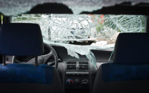 A car with shattered windows that requires car window repair
