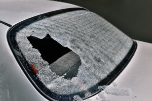 a car with a shattered rear window