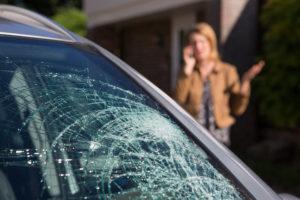 Woman in need of a car window replacement