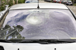 a car with a smashed window that requires car window repair
