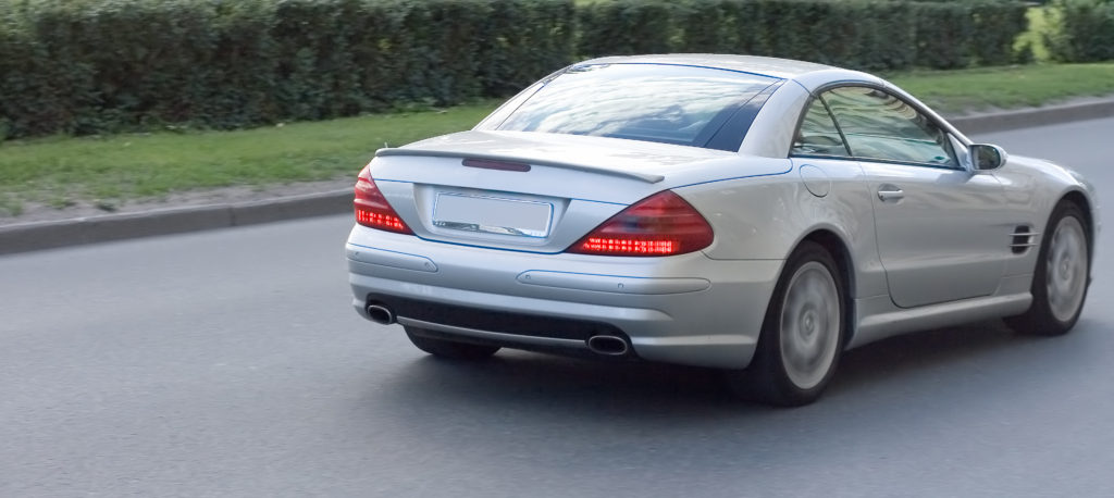 a silver luxury car with recent rear window replacement