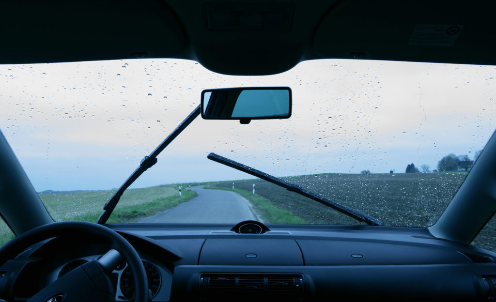 looking out at a clear windshield while it's raining
